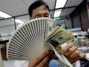 Курс доллара на мировых рынках снижается