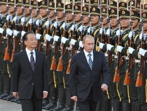 Путина в Китае встретили залпами орудий