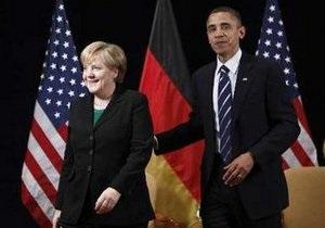 Обама вручил Меркель высшую американскую награду для гражданских лиц
