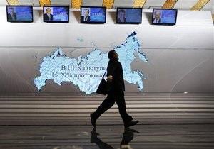 Путин побеждает на выборах после подсчетов трети бюллетеней
