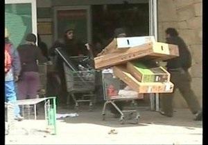 В канун Конца Света в Аргентине сотни человек грабили супермаркеты
