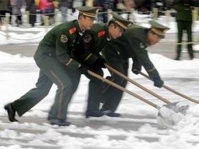 Сильный снегопад парализовал работу пекинского аэропорта: отменены десятки рейсов