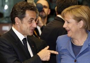 Саркози и Меркель согласовали план спасения Греции: деньги предоставят ЕС и МВФ