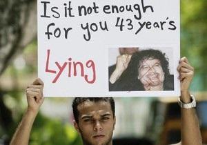 Каддафи в третий раз за ночь попросил ливийцев защитить Триполи