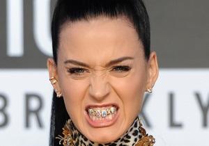 Модный тренд: Кэти Перри вслед за Рианной и Мадонной позолотила зубы