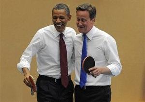 Обама сыграл с британским премьером в настольный теннис