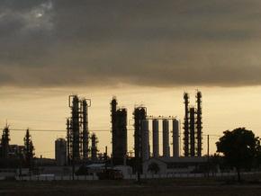 Обзор рынков: Цены на нефть понизились из-за прогнозов США
