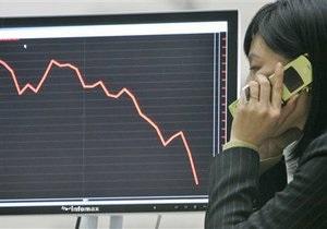 Обзор: Фондовые индексы снизились, металлы и нефть дешевеют