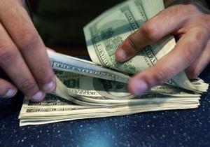 Украинские банки - Украинцы перестали снимать валютные сбережения с депозитных счетов - Ъ
