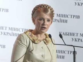 Тимошенко улетела в Ливию в платье в мусульманском стиле