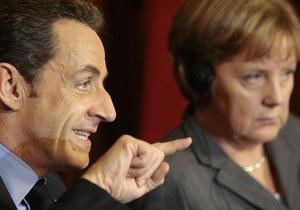 Меркель и Саркози: Неспособность Италии расплатиться по долгам будет означать конец евро