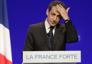 Саркози угрожает Стросс-Кану судебным иском