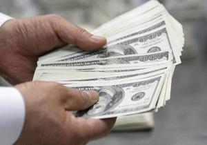 Курс гривны незначительно снизился к доллару на межбанке