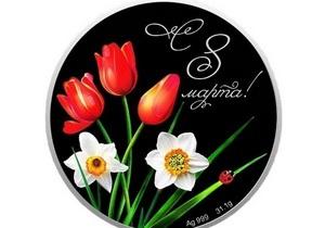 Ощадбанк выпустил к 8 Марта серебряную монету с кристаллами Swarovski