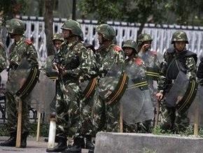 Беспорядки в Китае: полиция застрелила 12 человек