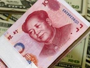 Китай проведет политику плавной девальвации юаня