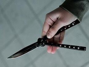 В Киеве школьник с помощью пистолета, ножа и бейсбольной биты завладел автомобилем