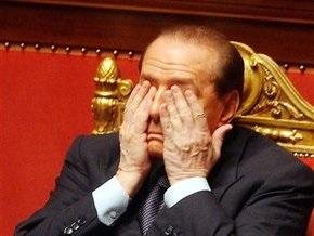Берлускони пообещал уйти в отставку, если подтвердятся слухи о его романе с моделью