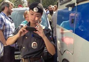 Российскую журналистку будут судить за публикацию фото курящей сотрудницы полиции