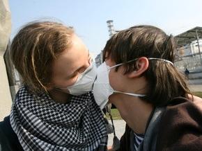 СМИ: Киевляне защищаются от вируса гриппа строительными масками