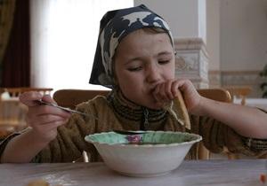 Депутат-регионал предлагает запретить иностранцам усыновлять украинских детей