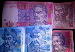 Банкиры удивлены новыми требованиями НБУ по продаже выручки - Ъ