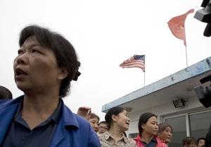 Китай - працівники - протест - заручники