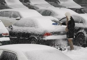 Фотогалерея: Весна нам тільки сниться. Березневий снігопад паралізував Київ