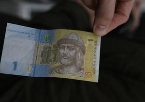 Азаров не оминув можливості запевнити українців у стабільності гривні