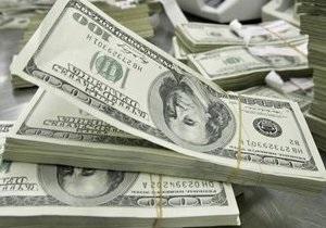 Долар і євро продовжують знижуватися на міжбанку