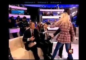 Регіонал побився з учасницею FEMEN у прямому ефірі