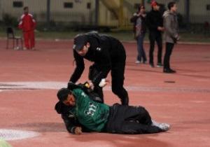 Фотогалерея: Поле смерти. Столкновения футбольных фанатов в Египте обернулись десятками жертв