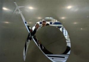 В 2009 году Boeing снизил чистую прибыль в два раза