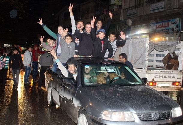 Некоторые жители Алеппо праздновали победу армии (фото: ЕРА/UPG)