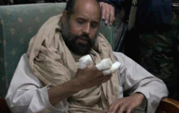 Сын Каддафи выступил по телевидению из тюремной камеры