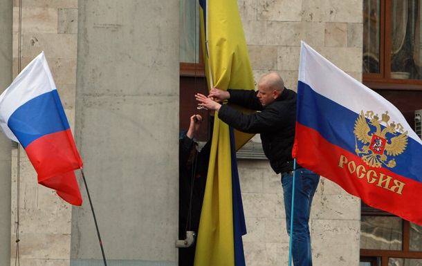 Восточную Украину охватила  война флагов  – КоммерсантЪ