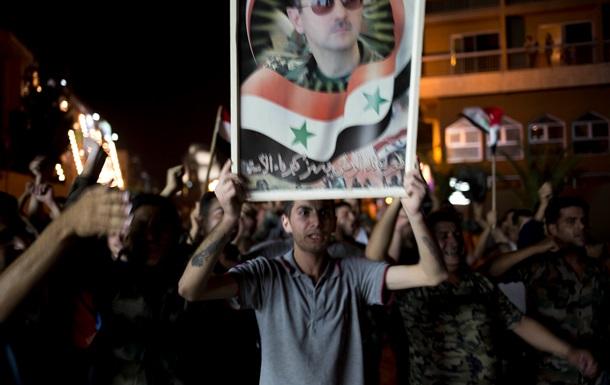 Сирийцы празднуют победу Асада на президентских выборах