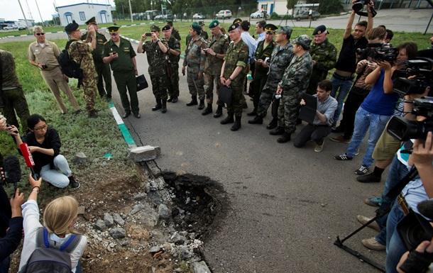 Как эксперты ОБСЕ осматривали воронку в российском Донецке