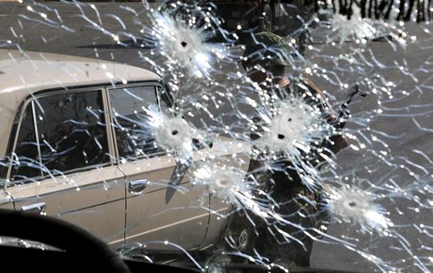 Обстрелянный Донецк и место расстрела силовиков - фото