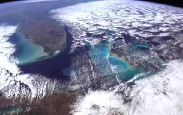 Земля в иллюминаторе: история уникальных снимков с МКС