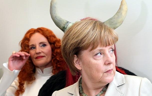 Удивила Путина, обняла коалу: самые яркие фото Меркель за 2014 год