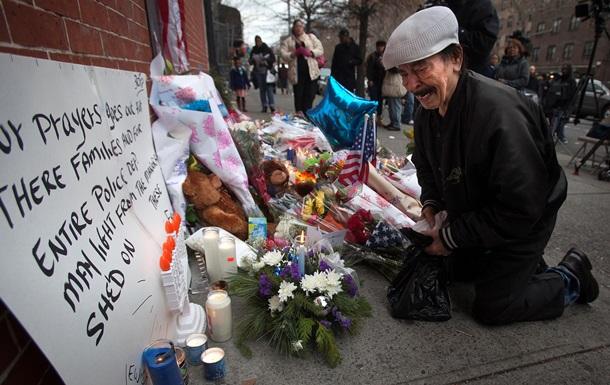 Нью-Йорк скорбит по убитым полицейским - репортаж