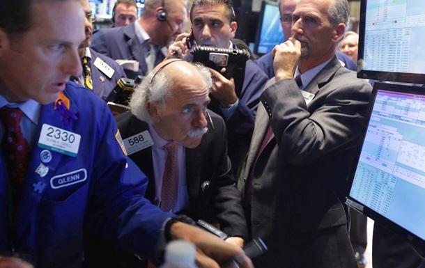 Торги на биржах США завершились снижением индексов