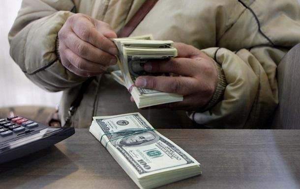 Украинцы сбрасывают доллар на  черном  рынке в интернете