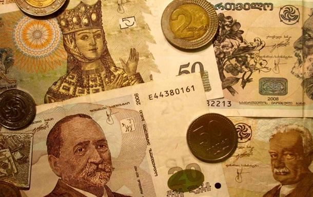 Отход от либерального курса ударил по грузинской валюте