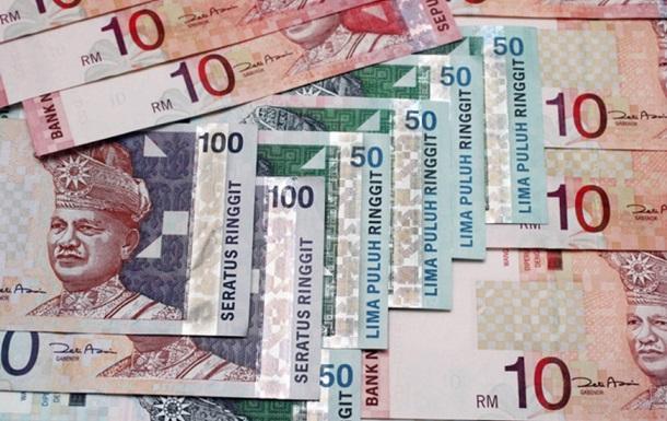 Курс малайзийской валюты рухнул до самого низкого уровня с 1999 года
