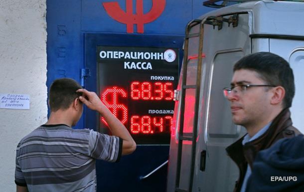 Рубль укрепился на фоне дорожающей нефти