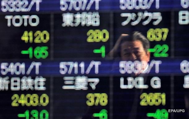 Решение Центробанка США отразилось на торгах Токийской биржи