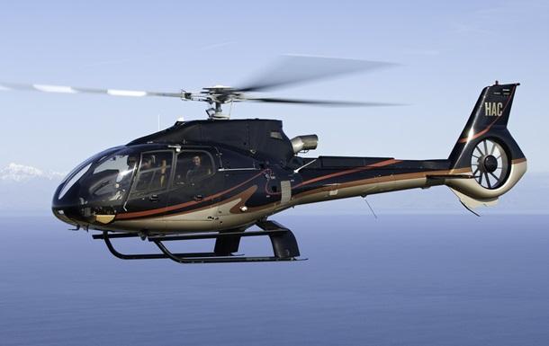 Потерпевший крушение вертолет стелами погибших подняли содна озера