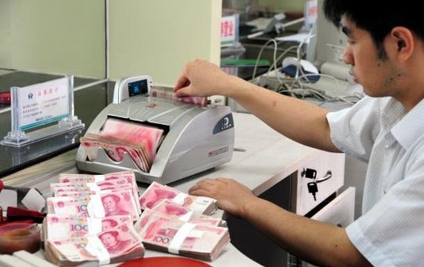 В Китае сотрудников банка били линейкой за плохие результаты
